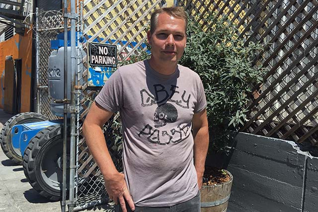 Artist Shepard Fairey expects to finish work on his Mission mural on August 12. Photo by Laura Waxmann