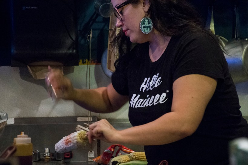 Chale making Elotes. Photo by Lola M. Chavez