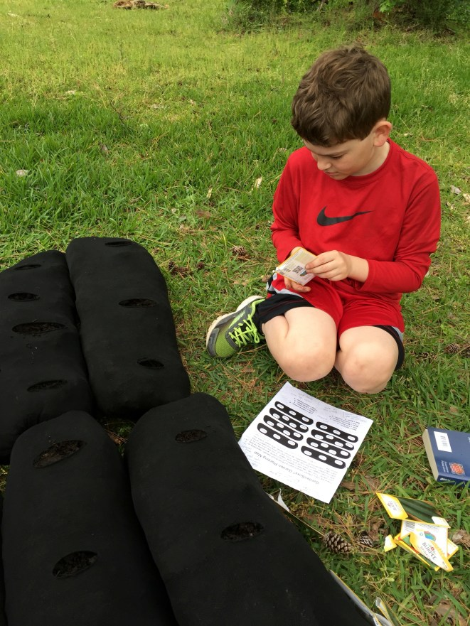 Love Where You Live - Mission Marshall - Family Garden Initiative - Socks and Child