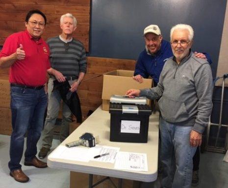 Rotary members sending books to Uganda