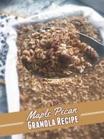 pecan granola on a serving spoon