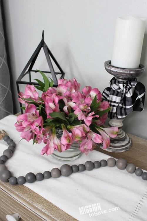 flowers in candle jar vase