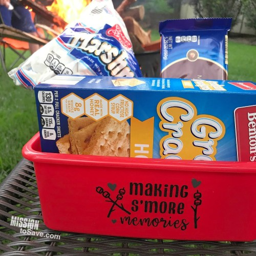 red caddy with s'mores supplies by campfire