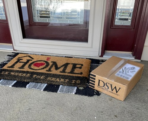 dsw shipping box on front porch