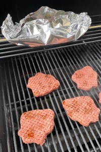 burgers and foil pack on grill