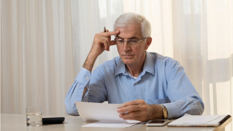 man-considering-financial-documents