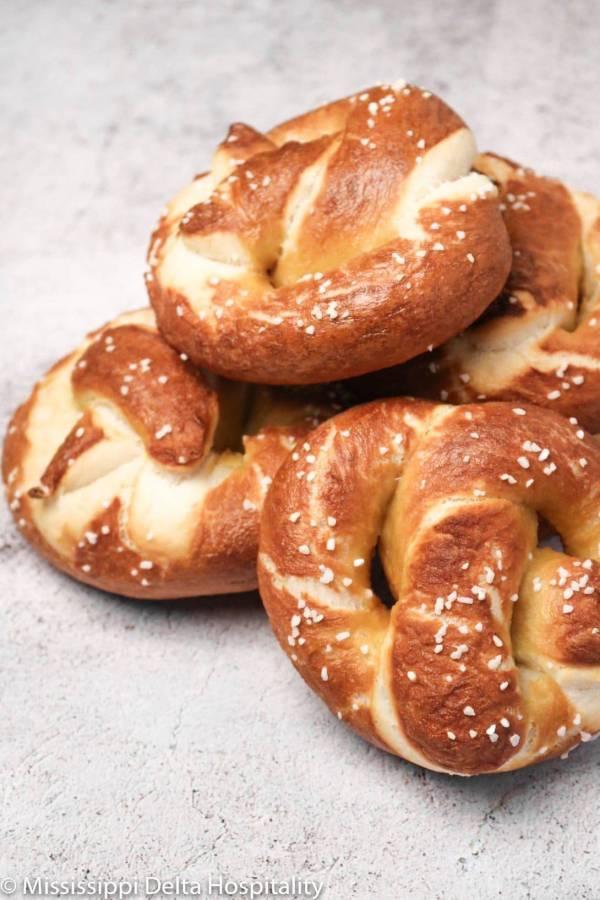 a pile of pretzels on a concrete board.