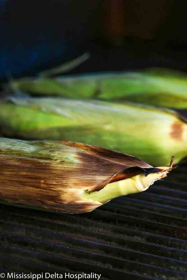 three ears of corn on a grill