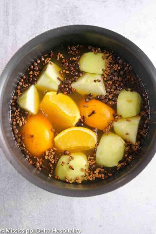 ingredients for apple cider in a large pot
