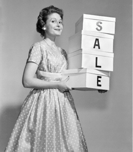 1950's woman holding shopping boxes