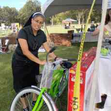 Sister Elena contmeplated a quick getaway on the new bicycle which was being raffled off.