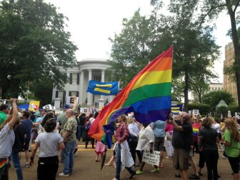 Approximately 300 people march in front of the Governor's Mansion protesting the Mississippi law allowing religious groups and some private businesses to deny services to same-sex couples and transgender people.