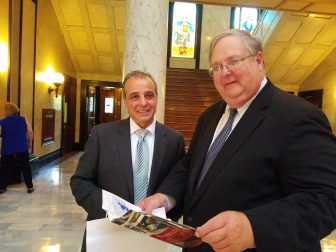 """Domenico """"Mimmo"""" Parisi, Ph.D., left, and Blake Wilson, right, presented the Nissan study in the State Capitol."""