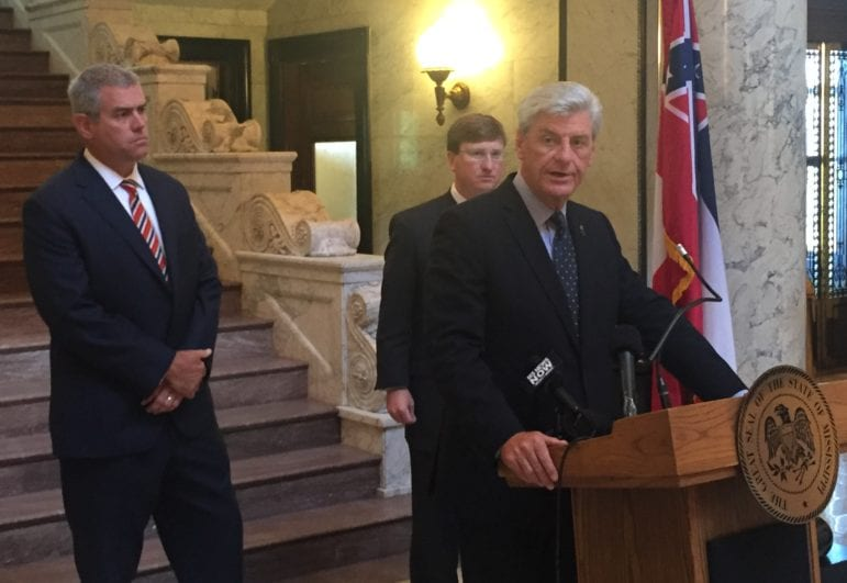 Gov. Phil Bryant speaks about state budget issues, flanked by House Speaker Philip Gunn, R-Clinton, left, and Lt. Gov. Tate Reeves.
