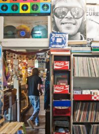 Vinyl records, cassettes, CDs, T-shirts, comic books, magazines, jewelry and posters fill the Little Big Store.