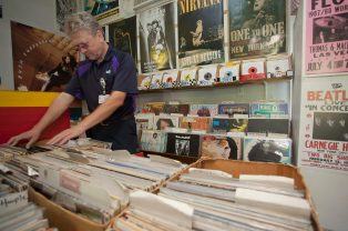 "Pearl resident Gary Tynes searches for a Fleetwood Mac record for his daughter's birthday Friday, July 8, at the Little Big Store in Raymond. ""I'm telling ya, vinyl is making a comeback,"" Tynes said. ""I'm a Beatles fanatic and now I've got my daughters turned into one too!"""