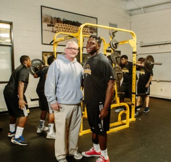 Jackoby Jones works out in the weight room with Starkville High football coach Ricky Wood.