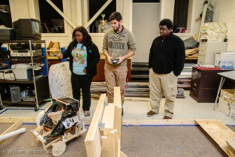 Lakendrea Young, 18, Eric Lowery, 15, and Chandler Cunningham, 15, work the robotics laboratory at Starkville High School.