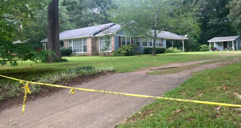 Held and Merrill's house in Durant. It has been cordoned off with police tape since police discovered their bodies last Thursday.