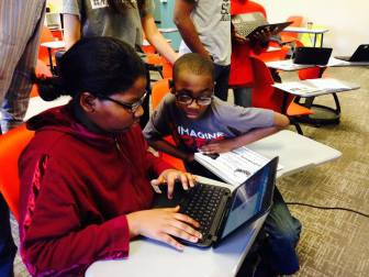 Students at ReImagine Prep charter school participate at a hackathon event last year.