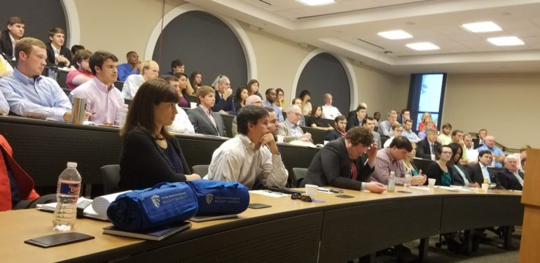 Participants listen to economic projections at the biannual Economic Growth Forum held at Millsaps College.