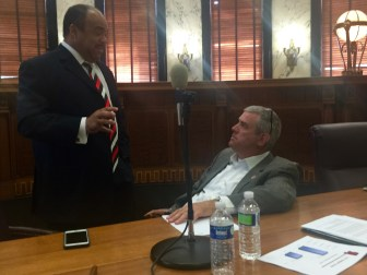Rep. Charles Young Jr., D-Meridian, and Speaker of the House Philip Gunn, R-Clinton, speak between working group sessions on Wednesday.