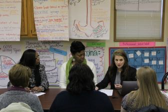 Jill Webb Hoda, assistant state literacy coordinator, works with children in Natchez-Adams School District.