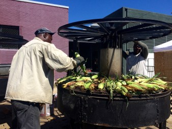 Vendors roasting corn at the Mississippi State Fair
