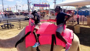 Two girls enjoy a camel ride at the Mississippi State Fair
