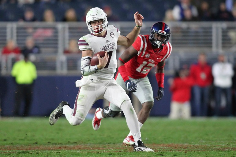 Mississippi State quarterback Nick Fitzgerald runs downfield against Ole Miss defender Tony Conner during The Egg Bowl Saturday at Vaught-Hemingway Stadium in Oxford Saturday,