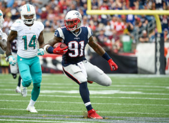 New England Patriots linebacker Jamie Collins (91) gains 13 yards after an interception in the 2nd quarter defended by Miami Dolphins wide receiver Jarvis Landry (14) during the NFL week 2 football game on Sunday, Sept 16, 2016 in Foxboro, Mass. The Patriots defeated the Dolphins 31-24.
