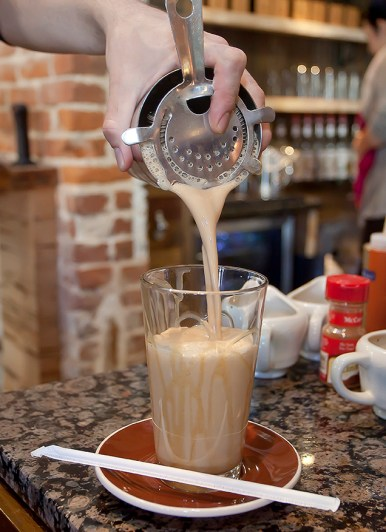A caramel frappe is poured at Steampunk Coffee Roasters in Natchez.