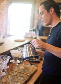Steampunk Coffee Roasters barista Robert Williams adds steaming water to a pour over roast recently at the expresso bar in Natchez.