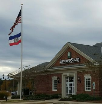 The Mississippi Economic Council's bicentennial banner flies at the Dogwood branch of BancorpSouth.