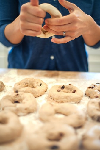 Marisol Doyle, co-owner of Big River Bagels, makes a bagel from scratch.