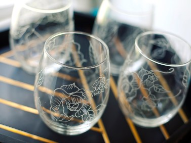 Hand-carved roses in full bloom on upcycled wine tumblers