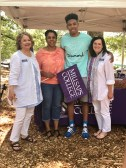 The Mississippi Society of Georgia awarded a scholarship to Joshua Leonce, a graduating high school senior from Alpharetta, Ga., who will attend Millsaps College in the fall. He is pictured with (left to right) Millsaps College Director of Alumni and Parent Relations Maribeth Kitchings, his mother Jo An Rochez and Lee Anne Bryan, also with Millsaps Alumni and Parent Relations.