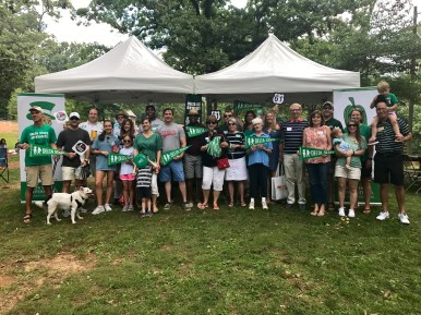 The Delta State family poses for a picture in front of their tent in Chastain Park.