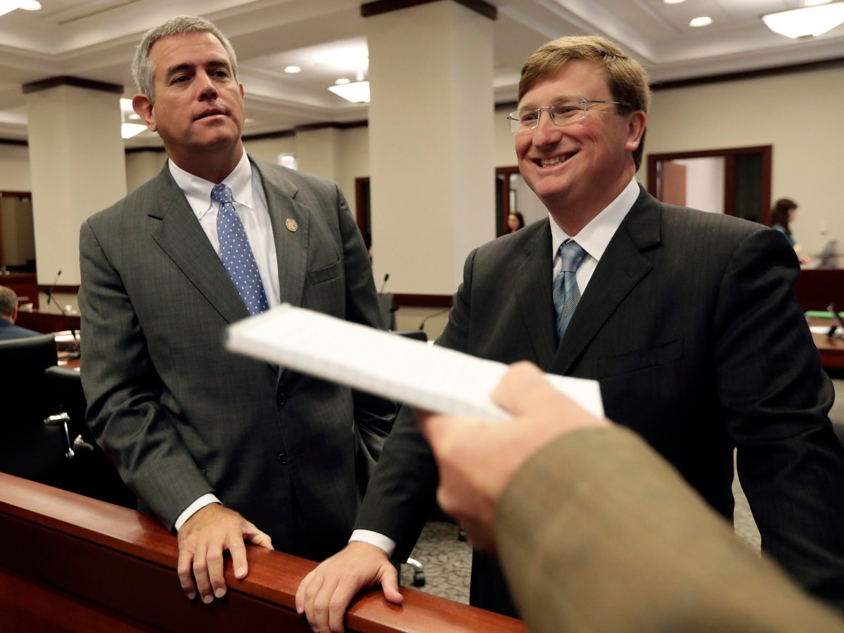 Tate Reeves, right, smiles as Philip Gunn, left.
