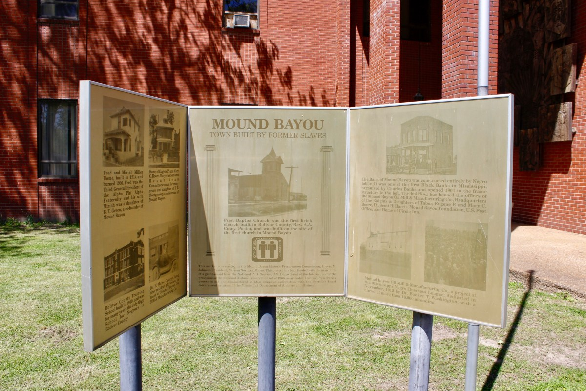 A sign outside of city hall in Mound Bayou depicts the town's history