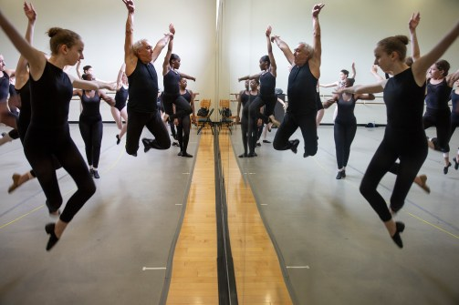 Marcus Alford, former student football trainer for the University of Alabama, center, teaches students techniques during a USA International Ballet Competition Dance School class at Belhaven University's Bitsy Irby Visual Arts and Dance Center in Jackson Tuesday, June 19, 2018.