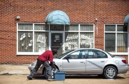 David Bradley, a resident of the Farish street Historic District, washes a car outside of Marshall's Music and Bookstore in the 600 block of North Farish Street in Jackson Friday June 29, 2018.
