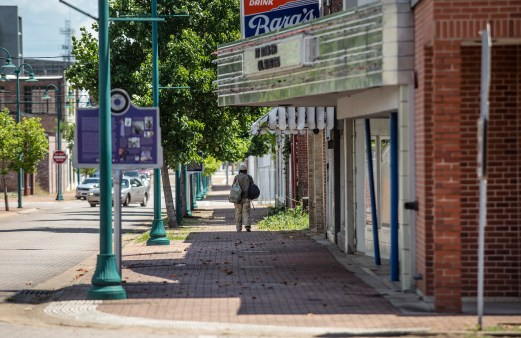 A pedestrian walks in the 300 block of North Farish Street in Jackson Friday, June 29, 2018.