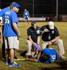 Mario Chickaway, 28, gets help from paramedics after suffering from a broken femur during the World Series of Stickball at the Choctaw Indian Fair in Choctaw Wednesday, July 11, 2018.