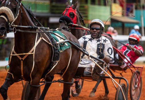 Harness racers compete during the second day of competition at the Neshoba County Fair in Philadelphia, Miss. Tuesday, July 31, 2018.