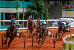 Racers round the dirt track on the second day of competition during the Neshoba County Fair in Philadelphia, Miss. Tuesday, July 31, 2018.