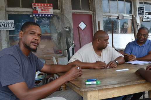 Ulysses Hentz plays a game of bones outside an old auto repair shop in Marks with Amos Taylor and Kenny Stanford. Mississippi Today dispatched reporters to all corners of the state and here in the Delta the majority of the people were concerned about more better paying jobs.
