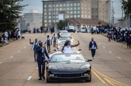 Mister JSU, Darrian B. Jackson, and Miss JSU, Gabrielle A. Baker, wave to the crowd during Jackson State's homecoming parade near JSU's campus Saturday, October 13, 2018.