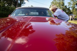 Father Paddy Mockler, right, blesses a classic car during the Blessing of the Classics in the 22nd Annual Cruisin' The Coast event on the Diamondhead Wednesday, October 3, 2018.