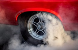 Tire smoke comes from a classic car during the Burn 'em Up in the Pass competition during the the 22nd Annual Cruisin' The Coast event in Pass Christian Thursday, October 4, 2018.